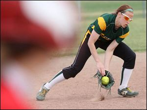 Partially obscured by a Bowling Green runner, Clay's Harleigh Isbell scoops up the ball.