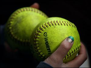Bowling Green's Haley Yarnell sported painted nails while she held extra softballs in the dugout.