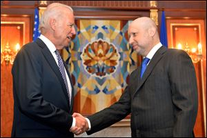 U.S. Vice President Joe Biden, left, is greeted by Oleksandr Turchynov, the acting Ukrainian prime minister and president, today in Kiev.