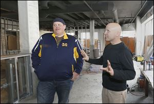 Co-owners Franz Gilis, left, and Nick Kubiak talk about their wine bar that's being built inside the Commodore Perry Apartments building in Toledo. They hope to be open by the end of spring.
