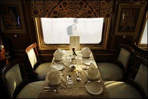 A table is set for passengers inside one of the luxurious cabins of India's Palace on Wheels.