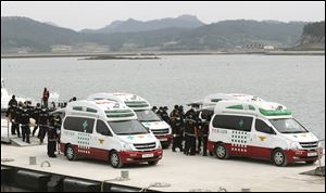 Emergency workers carry the bodies of passengers aboard the Sewol ferry.