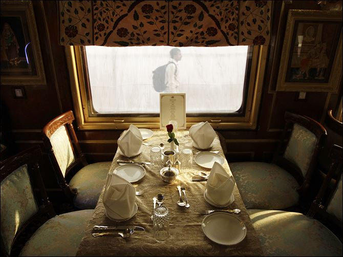 0001010100020000000 A table is set for passengers inside one of the luxurious cabins of India's Palace on Wheels.