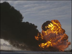 A fireball going up at the site of an oil train derailment in Casselton, N.D. on Dec. 30.