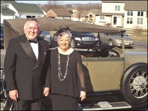 Chairmen of the Great Gatsby Gala presented by Mercy St. Charles Hospital, Dick and Sandy Fisher, stand next to the 1928 Ford Convertible.