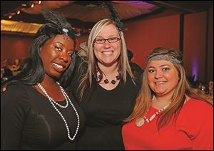 Pasha Wilson, left, Wendy Mills, center, and Lindsey Tumbleson at the Alzheimer's Association Great Gatsby.