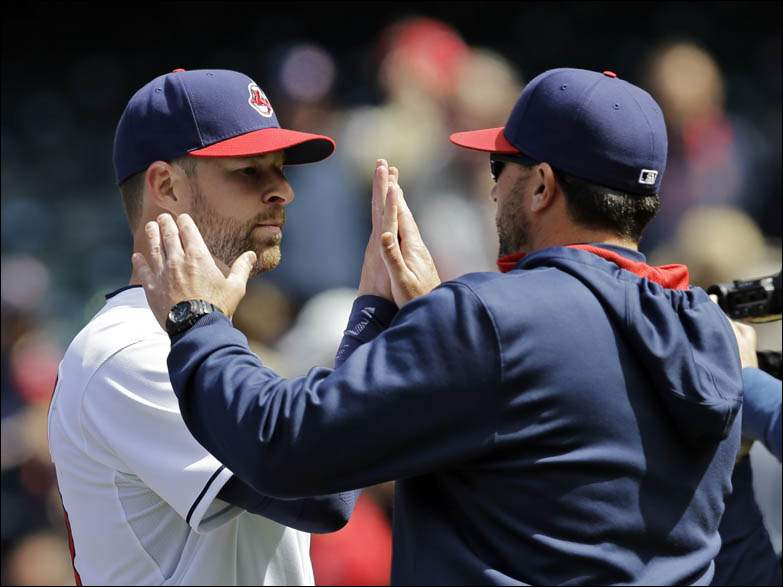 Cleveland Indians starting pitcher Corey Kluber, left, is greeted by pitching coach Mickey Callaway after a complete game, 5-1 win.
