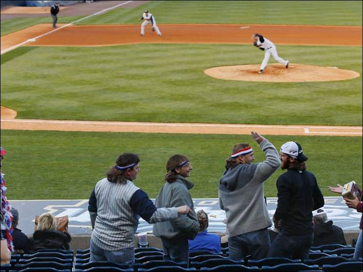 From left: Jason Rhodes, Ryan Burkholder, Harrison Auger, 15, and his dad Jamie Auger, Adam Rhodes and Jared Ramey wear mullet wigs during the Mud Hens game. The men, mostly from Bluffton, Ohio, were celebrating a bachelor party.