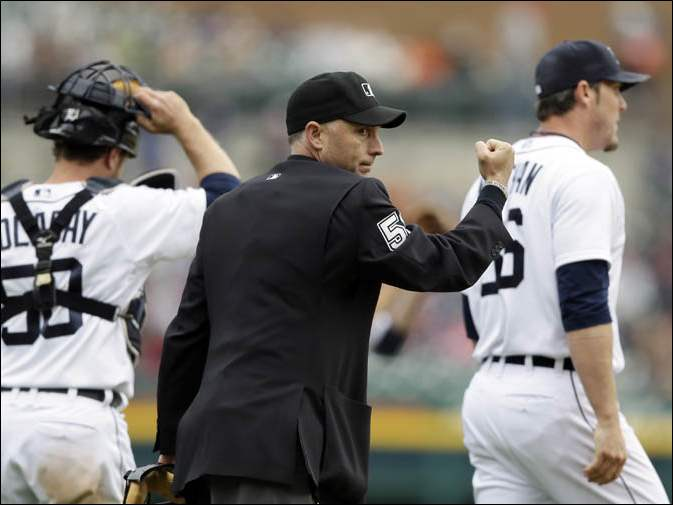 Home plate umpire Dan Iassogna signals the out call on Chicago White Sox's Marcus Semien.