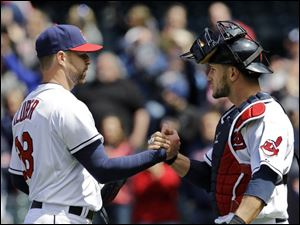 Cleveland Indians starting pitcher Corey Kluber, left, is congratulated by catcher Yan Gomes after a complete game.