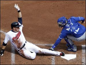 Cleveland Indians' Asdrubal Cabrera, left, is tagged out at the plate by Kansas City Royals catcher Brett Hayes.