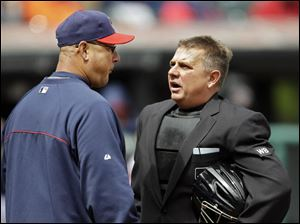 Indians manager Terry Francona, left, questions home plate umpire Greg Gibson on a play at the plate.