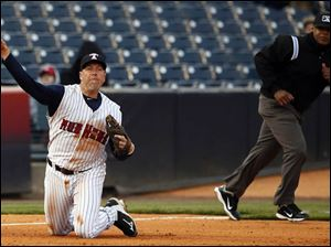 Toledo Mud Hens third baseman Mike Hessman makes a play against the  Indianapolis Indians.
