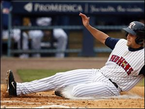 Toledo Mud Hens first baseman Jordan Lennerton scores a run on the slide.