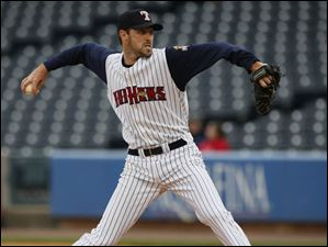Toledo Mud Hens pitcher Derek Hankins throws a pitch.