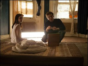 "Olivia Cooke, left, and Sam Claflin in a scene from ""The Quiet Ones."""