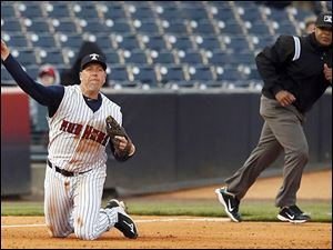 Mud Hens third baseman Mike Hessman makes a play during the fourth inning on Thursday night against Indianapolis.