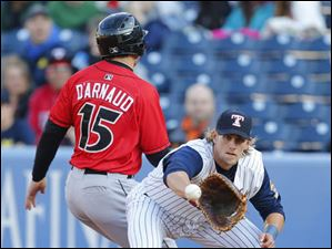 Jordan Lennerton waits for the throw as Indianapolis Indians player Chase d'Arnaud is safe back at first.