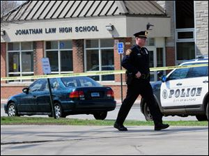 Police remain on scene at Jonathan Law High School after a 16-year-old girl was stabbed to death in Milford, Conn., today.