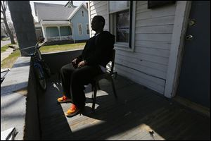 A former member of the Manor Boyz sits on the porch of a family member's home and talks about the past year of his life. But not everyone has left the streets.