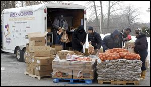 Local companies are supporting Food for Thought, an organization that distributes food to people in need, shown here at Holy Trinity Lutheran Church in Toledo on Feb. 9, 2011.