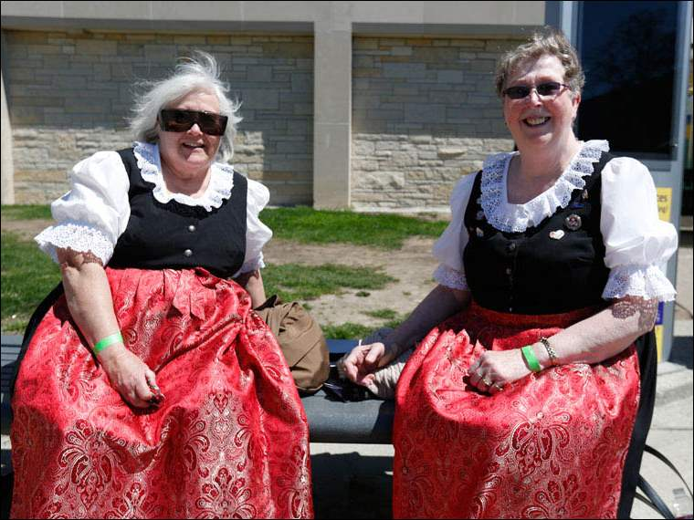 Toledo Swiss Singers Barb Moellman, left, and Roberta Gacsal, both of Elmore, outside the Student Union.