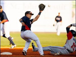 Gwinnett RF Derrick Mitchell steals second base against Toledo Mud Hens SS Hernan Perez during the fourth inning.
