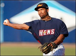 Toledo Mud Hens second baseman Marcus Lemon makes a throw to first base.