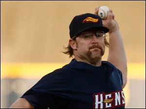 Mud Hens pitcher Nate Robertson  throws a pitch against Gwinnett