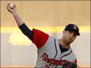 Gwinnett pitcher Cody Martin throws against the Toledo Mud Hens.
