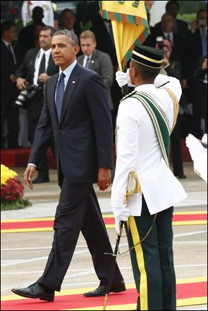 U.S. President Barack Obama walks after a welcome ceremony today at Parliament Square in Kuala Lumpur, Malaysia.