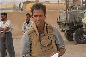 Military historian Rick Atkinson while of location in Iraq.