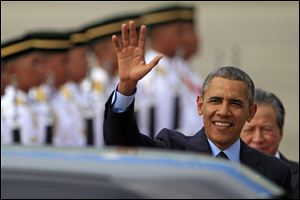 U.S. President Barack Obama waves upon his arrival for his three-day visit in Malaysia today at the Royal Malaysian Air Force base in Subang