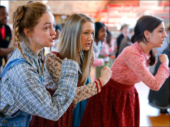 Seniors Jacquelyn Adamson, left, Courtney Krizman and Emily Musallam perform a number during dress rehearsal for 'The Musicman' at Central Catholic.