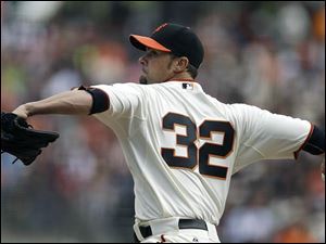 San Francisco Giants' Ryan Vogelsong works against the Cleveland Indians in the first inning.