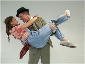 Meghan Oberle, as Polly Baker, is held by Derek Kastner, who plays Bobby Child, in a scene from during dress rehearsal of the play 'Crazy For You' at St. Francis.