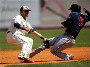 Gwinnett's Edward Salcedo steals 2nd base despite the efforts of Hens second baseman Brandon Douglas.