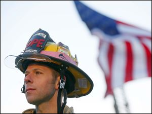 Perkins Township Firefighter Brian Hackenburg waits near the starting line to run the marathon.