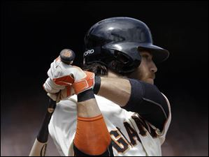 San Francisco Giants' Brandon Crawford swings for an RBI double off Cleveland Indians' Danny Salazar.