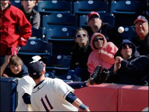 Hens right fielder Ben Guez and second baseman Brandon Douglas go after a foul ball.
