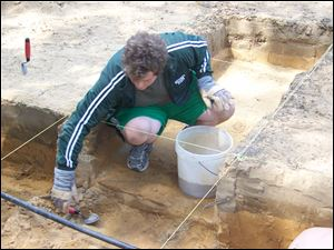 Josh Lieto, a former archaeology student of Professor Ken Mohney and a current volunteer, working on a dig in Temperance last summer. Professor Mohney teaches archaeology at Monroe County Community College and will speak May 5 at the Bedford Branch Library.