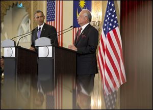 U.S. President Barack Obama and Malaysian Prime Minister Najib Razak participate in a joint news conference today at the Prime Minister's Office, in Putrajaya, Malaysia.
