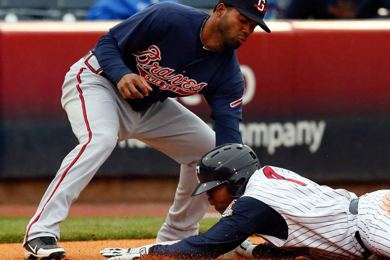 Toledo-Mud-Hens-RF-Ezequiel-Carrera-steals-third-base-against-Gwinnett-s-Edward-Salcedo-during-the-first-inning