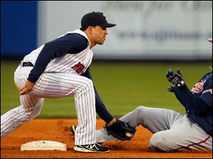 Toledo Mud Hens SS Hernan Perez tags out Gwinnett's Edward Salcedo at second base during the fourth inning.