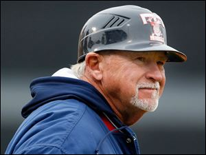 Toledo Mud Hens manager Larry Parrish watches the action.