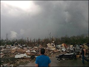 A tornado rolled through Mayflower, Ark., on Sunday night. A powerful storm system rumbled through the central and southern United States on Sunday, spawning several tornadoes, including one  in a small northeastern Oklahoma city and another that carved a path of destruction through several northern suburbs of Little Rock, Ark.