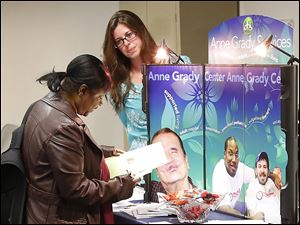 Stautzenberger College student Cheryl Franklin speaks to Anne Grady Services representative Stephanie Reighard during the Community Volunteer Fair at Stautzenberger in Maumee.