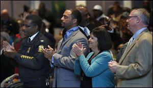 From left: Toledo Police chief William Moton, TPS superintendent Dr. Romules Durant, Tina Skeldon-Wozniak and Mayor Michael Collins attend the Toledoans United for Social Action's 2014 Nehemiah action meeting at Friendship Baptist Church in Toledo.