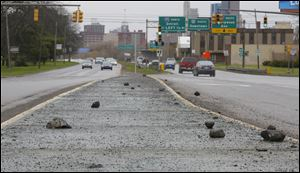 Pieces of concrete on the median in between the north and south bound lanes on the Anthony Wayne Trail heading toward downtown.