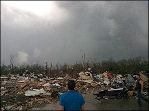 Tornado damage, Sunday in Mayflower, Ark. A powerful storm system rumbled through the central and southern United States on Sunday, spawning several tornadoes, including one that killed two people in a small northeastern Oklahoma city.